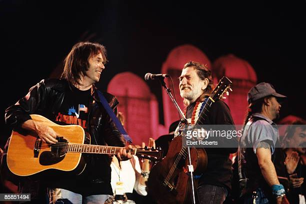 AID Photo of Willie NELSON and Neil YOUNG Neil Young and Willie Nelson performing on stage at Farm Aid held at the Hoosier Dome in Indianapolis USA...
