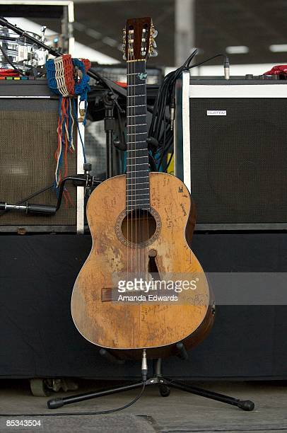 """Photo of Willie NELSON; Willie Nelson' acoustic guitar """"Trigger"""" on stage at the Rodeo Grounds"""