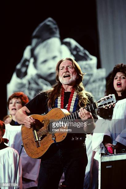 AID Photo of Willie NELSON Willie Nelson performing on stage at Farm Aid