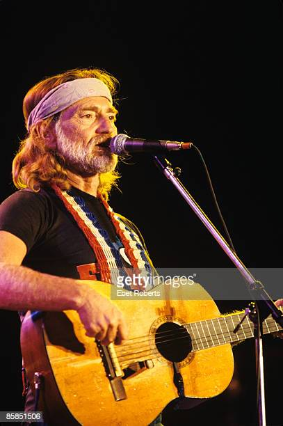 AID Photo of Willie NELSON Willie Nelson performing on stage at the first Farm Aid concert
