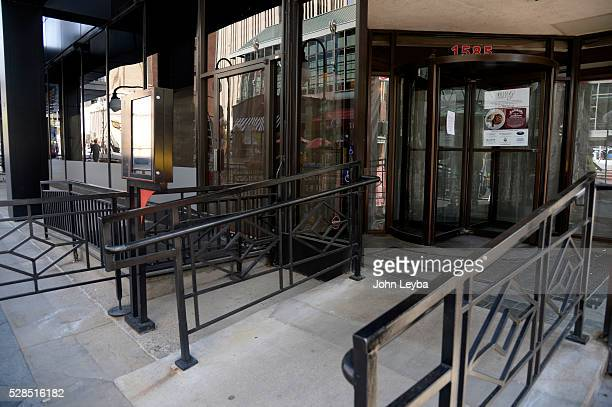 Photo of Willy G's on the 16th street mall at Lawrence St May 5 2016 has it's windows blacked out and closed up The Restaurant closed its doors...