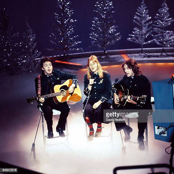 CENTRE Photo of WINGS and Paul McCARTNEY and Linda McCARTNEY and Denny LAINE LR Paul McCartney Linda McCartney Denny Laine performing on Mike Yarwood...