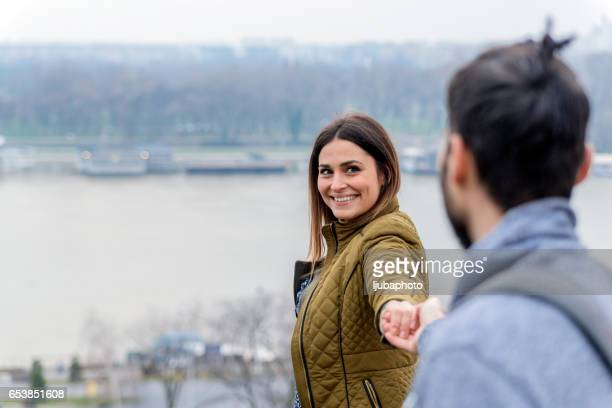 Photo of Woman discovering city holding boyfriend's hand