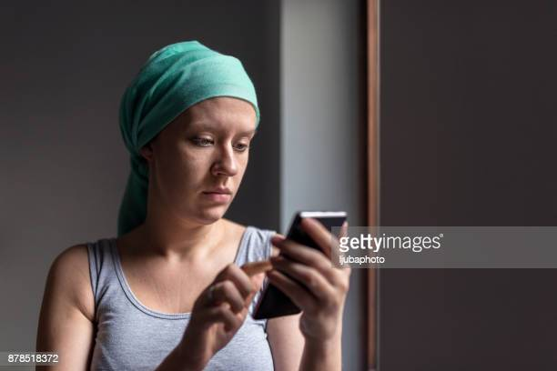 Photo of Woman using smartphone while fighting breast