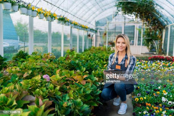 Photo of woman working in green house