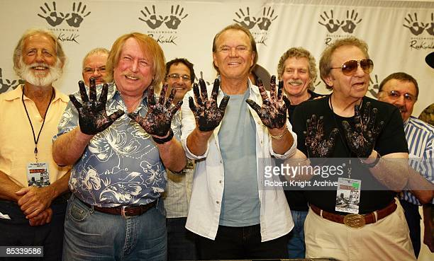 CENTER Photo of WRECKING CREW and Don RANDI and Glen CAMPBELL and Hal BLAINE Don Randi Glen Campbell and Hal Blaine make handprints at the Wrecking...