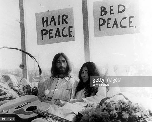 Photo of Yoko ONO and John LENNON with Yoko Ono posed at their famous BedIn at the Amsterdam Hilton