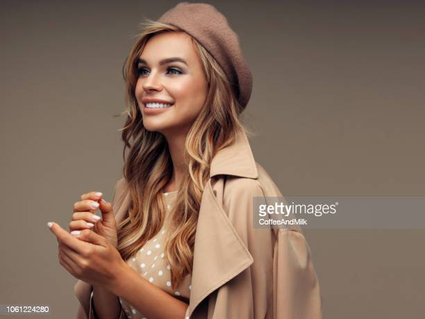 photo of young beautiful happy smiling lady wearing stylish - brown hat stock pictures, royalty-free photos & images