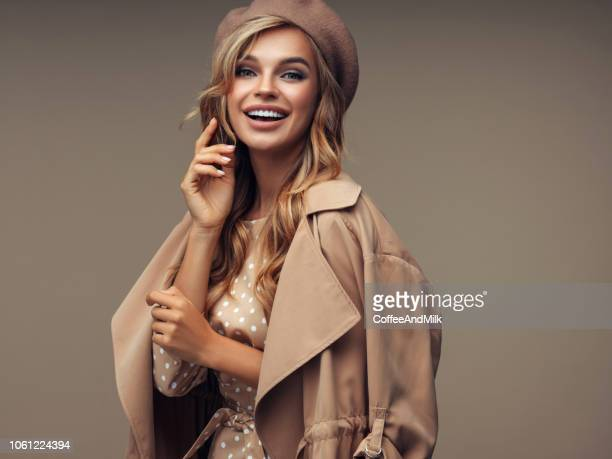 photo of young beautiful happy smiling lady wearing stylish - coat stock pictures, royalty-free photos & images