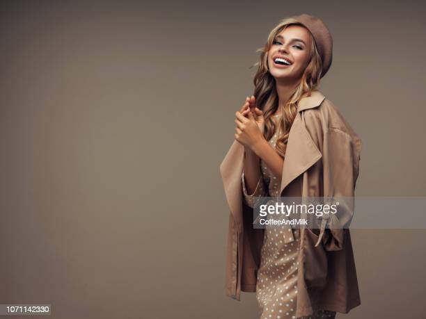 photo of young beautiful happy smiling woman wearing stylish - overcoat stock pictures, royalty-free photos & images