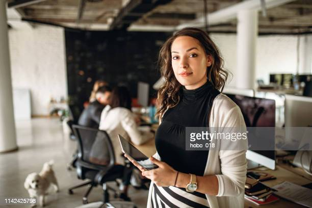 photo of young business woman in the office - entrepreneur stock pictures, royalty-free photos & images