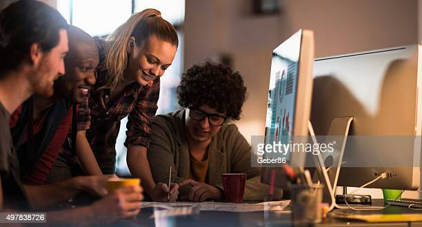 Photo of young freelance designers working in office