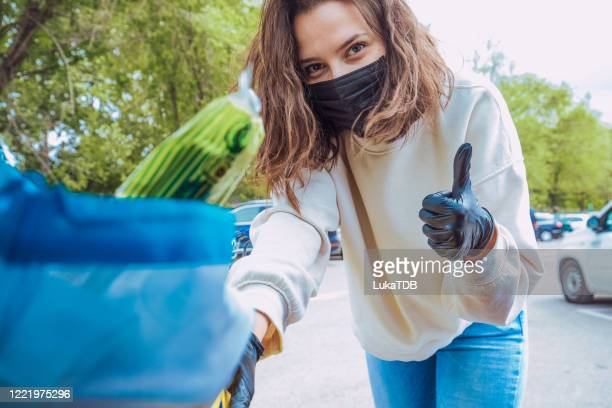 photo of young woman, she packing their groceries in her car - white boot stock pictures, royalty-free photos & images