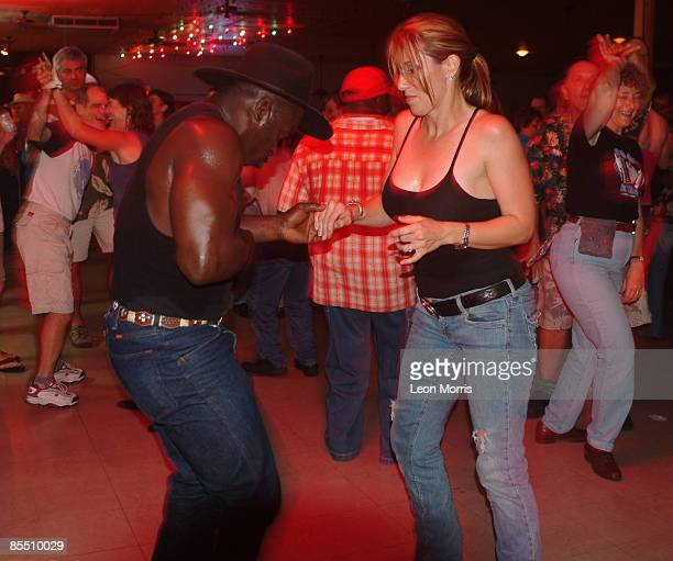 Photo of ZYDECO; dancers, dancing to Zydeco music in a bar in New Orleans
