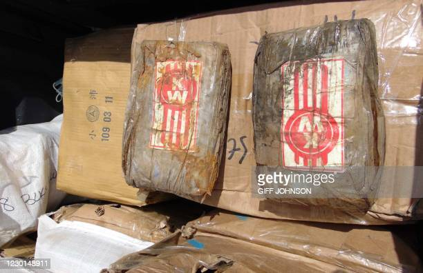 "Photo on December 15, 2020 shows a box filled with one-kilo ""bricks"" of cocaine after a transfer to a police pickup truck from a patrol vessel that..."