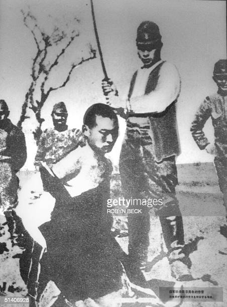 A 1937 photo on display at the Museum of the War of Resistance Against Japan shows Imperial Army soldiers about to behead a Chinese man in Nanjing...