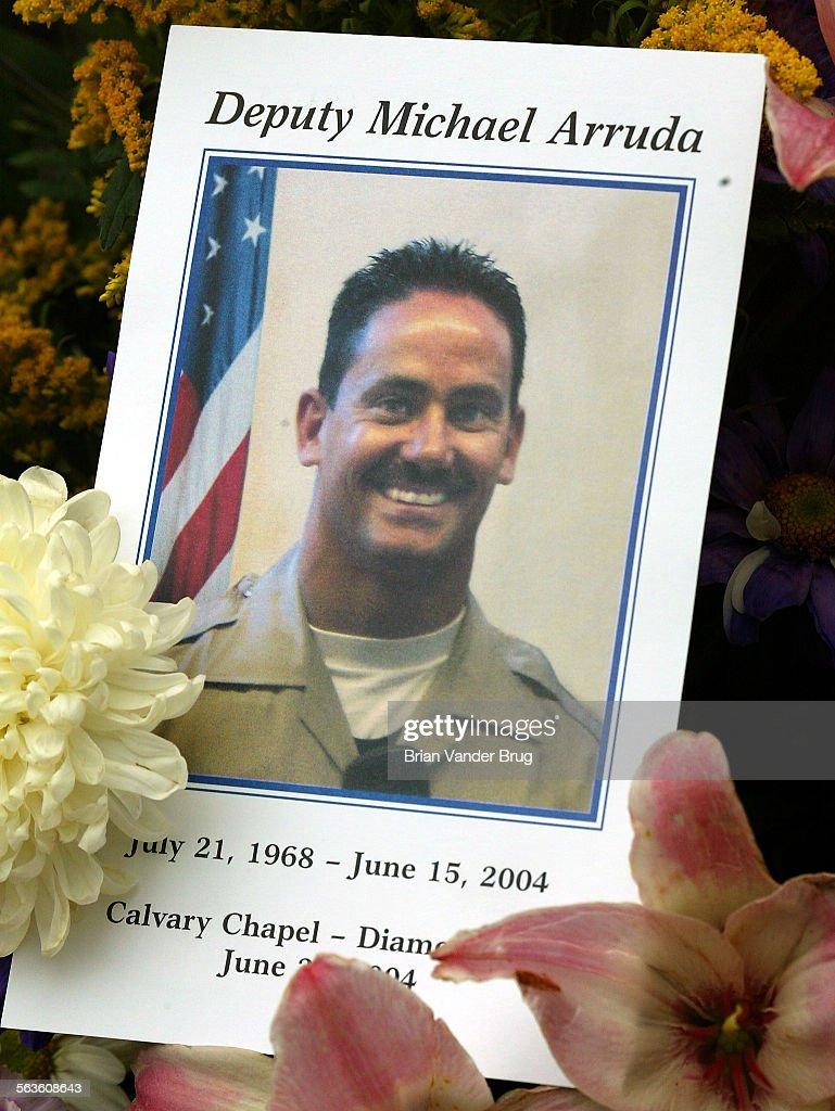 Photo Program On Flowers At Funeral For La Sheriffs Deputy Michael