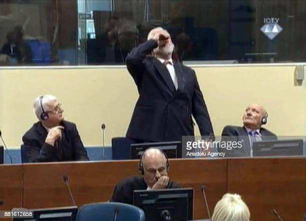 Photo provided by ICTY shows Crotian Former General Slobodan Praljak drinking a small bottle of liquid claimed to be poison after judges reconfirmed...