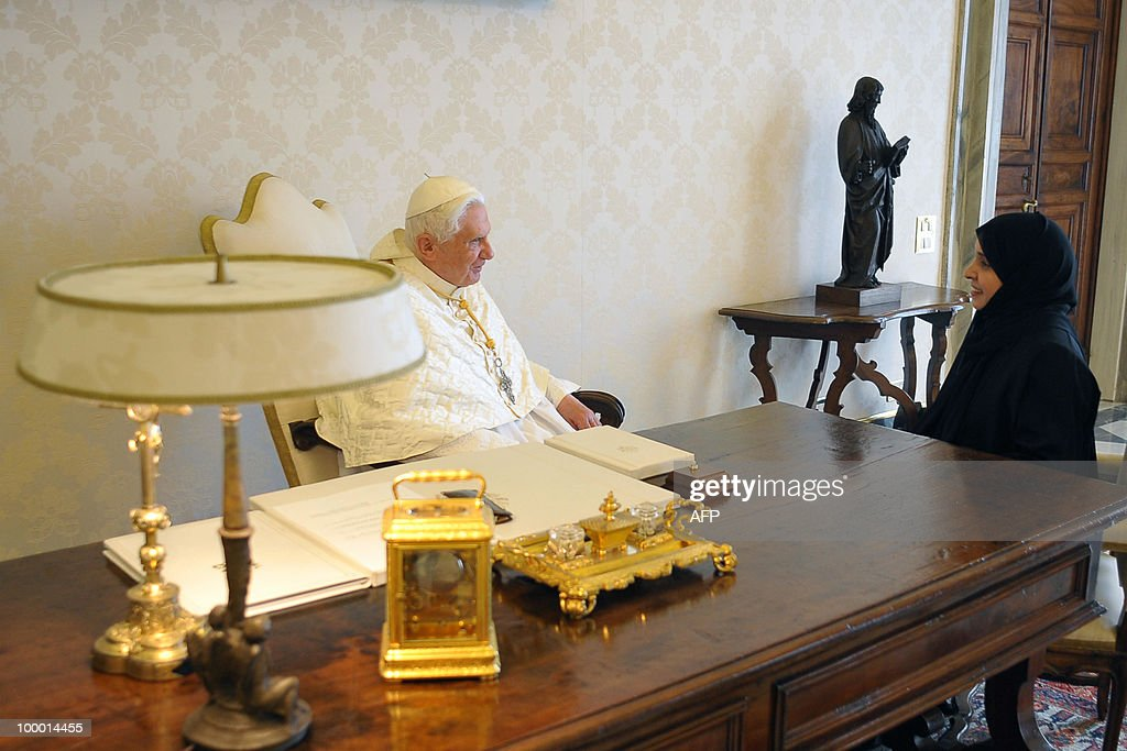 Photo relayed by Osservatore Romano shows Pope Benedict XVI receiving the credentials of Hissa Abdullah Ahmed Al-Otaiba (R), the first ambassador of the United Arab Emirates to the Holy See, at the Vatican on May 20, 2010. AFP PHOTO / Osservatore Romano/ Francesco Sforza