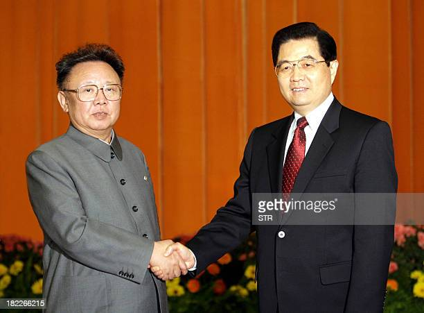 A photo released by China's Xinhua new agency shows Chinese President Hu Jintao shaking hands with North Korean leader Kim Jong Il inside the Great...