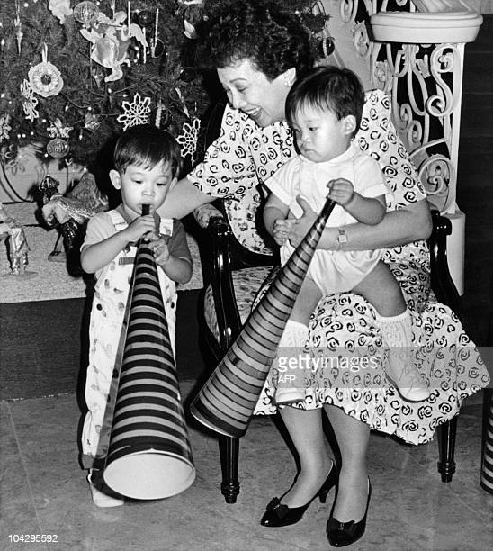 Photo released by Malacanang Palace on December 31, 1987 shows the President of the Philippines Corazon Aquino teaching her grandchildren Justin...