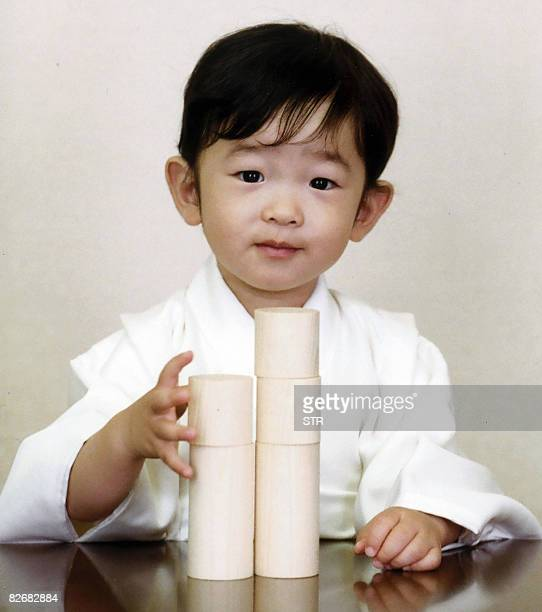 Photo released by the Imperial Household Agency show Japanese Prince Hisahito, son of Prince Akishino and Princess Kiko, piling blocks at their...