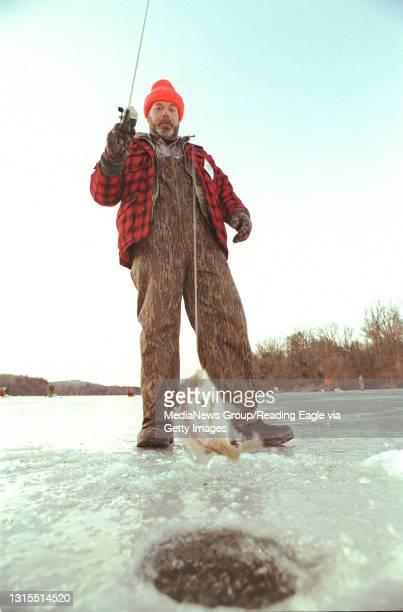 Photo Ryan McFadden 200004959 Lifestyle Icefishing story, Lake Ontelaunee, Peter's Cove; Darryl R Dunkelberger, of sinking spring pulls a sunfish...