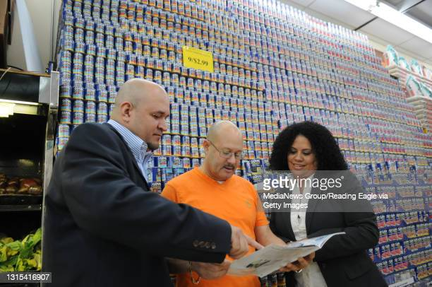 Photo Ryan McFadden El Palo Magazine partners visit with their first advertiser, Fine Fare Supermarket in Reading; from left is partner Jose Alexis...