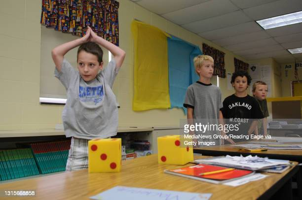 Photo Ryan McFadden Math Fact Academy at Lorane Elementary School in Exeter; Teacher Josie Whitney has the kids play a game where they roll dice,...