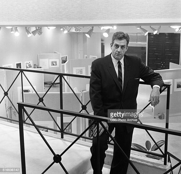 A photo shoot at the Raymond Burr Galleries 456 North Rodeo Drive Beverly Hills CA Burr on upper balcony overlooking main display floor Image dated...
