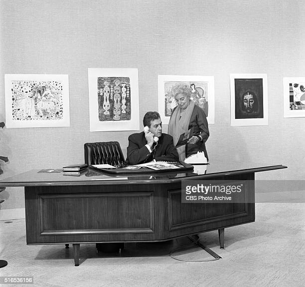 A photo shoot at the Raymond Burr Galleries 456 North Rodeo Drive Beverly Hills CA Shown here is Raymond Burr and Hilda Swarthe in the gallery Image...