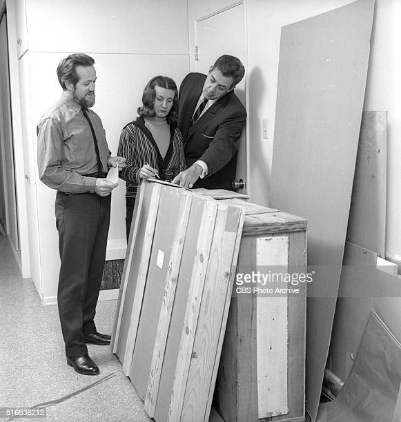 A photo shoot at the Raymond Burr Galleries 456 North Rodeo Drive Beverly Hills CA Frank Petek and Poko Petek and Raymond Burr with crates for...