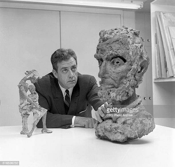 A photo shoot at the Raymond Burr Galleries 456 North Rodeo Drive Beverly Hills CA Burr with bronzes Woman Holding Boy and bust of Lincoln by...