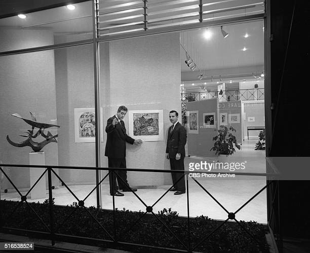 A photo shoot at the Raymond Burr Galleries 456 North Rodeo Drive Beverly Hills CA Shown here is Raymond Burr with Frank Vitti seen through the...