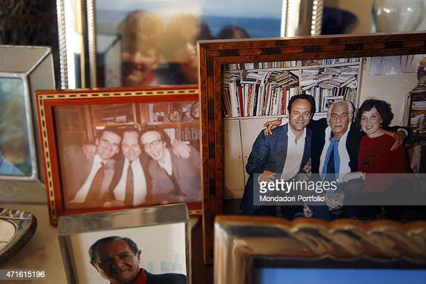 """Photo shooting at director and actor Carlo Verdone's home. Detail of some pictures: on the left Carlo Verdone hugging Italian actors Massimo Troisi..."