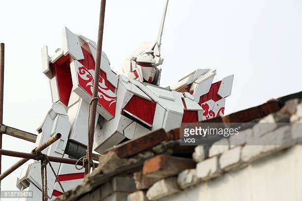 TAI'AN CHINA MARCH 04 Photo shows a 66metre tall statue of popular television animation hero Gundam made by a college student on March 4 2016 in...