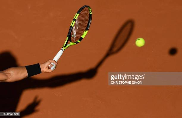 TOPSHOT Photo shows a close up of the racket and shadow of Spain's Rafael Nadal hiting a return to Austria's Dominic Thiem during their semifinal...