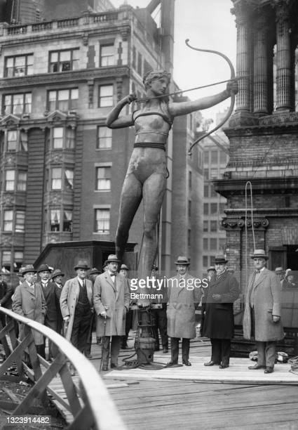 Photo shows a closeup of Diana, the famous Saint Gaudens which has perched atop Madison Square Garden for many years. She was met by a delegation...
