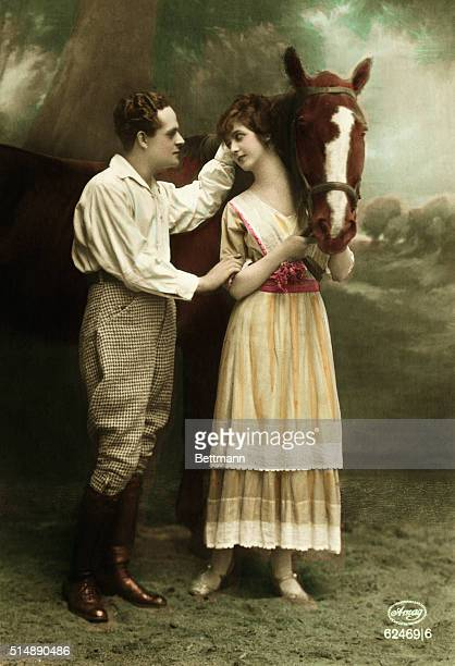 Photo shows a couple 'horsing around' The gent appears to be courting the young lady Undated