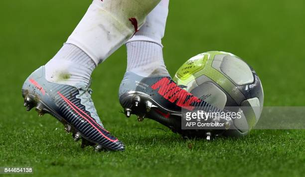 A photo shows a detail of Bordeaux's Brazilian midfielder Malcom's football boots reading 'MalcomX Familia' as he controls the ball during the French...