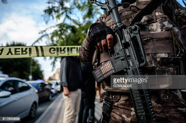A photo shows a detail of the gun of a Turkish special forces police officer as he patrols at the scene of a blast near a police station in Istanbul...