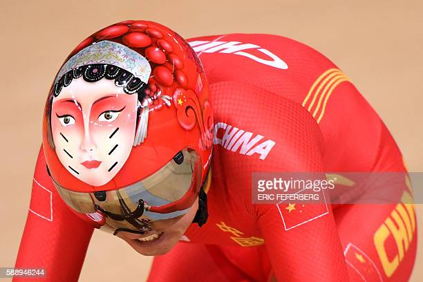 TOPSHOT A photo shows a face painted on the helmet of China's Zhong Tianshi as she competes in the women's Team Sprint qualifying track cycling event...