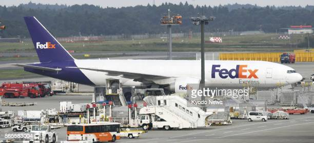 Photo shows a FedEX airplane arriving at Narita airport in Chiba near Tokyo on Oct 24 2017 Smoke was seen from its front tires while taxiing after...