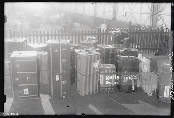 Photo shows a few of the trunks belonging to Queen Marie and her entourage being placed at pier awaiting arrival of transportation vehicles to take...