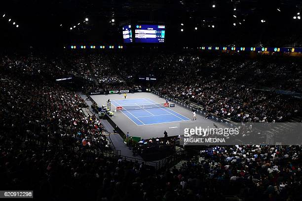A photo shows a general view of the Central Court during the third round tennis match between Japan's Kei Nishikori and France's JoWilfried Tsonga at...