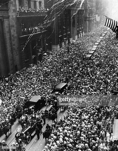 Photo shows a general view of the Ederle welcoming procession coming up lower Broadway the street jammed with humanity from side to side while...