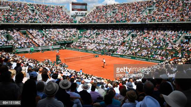 A photo shows a general view of the Philippe Chatrier court as Britain's Andy Murray returns the ball to Switzerland's Stanislas Wawrinka during...