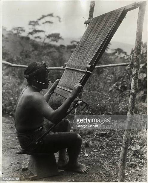 Photo shows a Jivaro warrior weaving This loom is now in the Von Hagen Collection of the Museum of the American Indian
