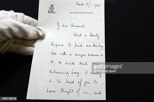 Photo shows a letter written by Elizabeth Bowes-Lyon, Queen consort of the United Kingdom on November 17, 2014 in Paris, before an auction sale of...