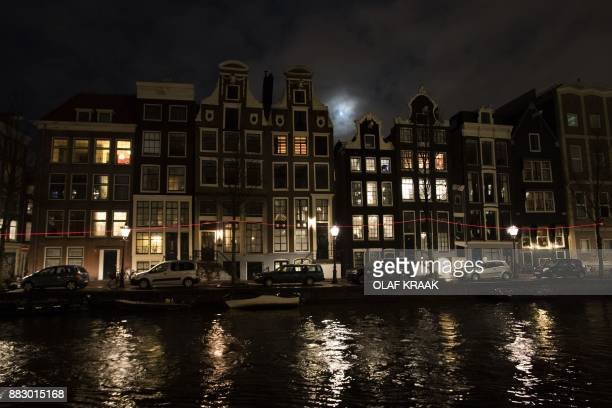 A photo shows a light sculpture at the Herengracht in Amsterdam on November 30 2017 During the Amsterdam Light Festival there is a route of...